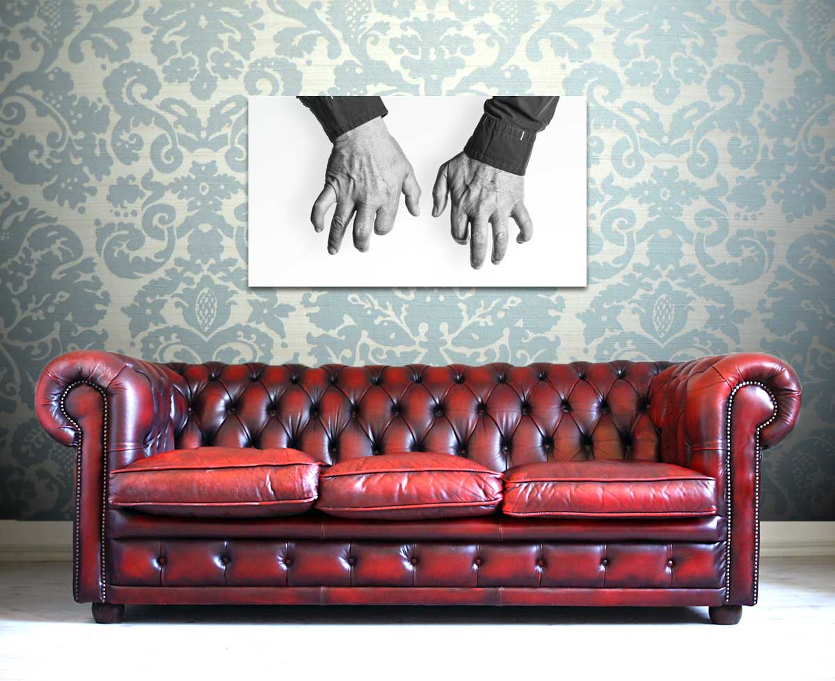 Picture of Joachim Kühn's HANDS over a red sofa.